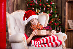 Cute little girl smiling with present near the Royalty Free Stock Images