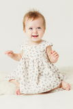 Cute little girl smiling sitting on the hide Stock Images