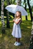 Beautiful little girl looks away dreaming royalty free stock photos