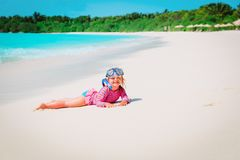Cute little girl snorkeling on beach. Cute little girl snorkeling on tropical beach Royalty Free Stock Images