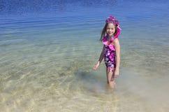 Cute little girl snorkeling in the ocean Stock Image