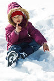 Cute little girl in snow Royalty Free Stock Image