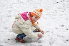 Cute little girl in the snow stock photos