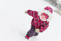 Cute little girl in snow Stock Images