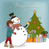 Cute little girl with snowman Stock Photo