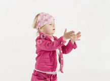 Cute little girl between soap bubbles Stock Photo
