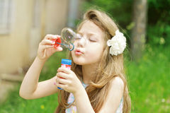 Cute little girl with soap bubbles Stock Photo