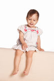 Cute little girl on sofa Royalty Free Stock Photography