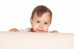 Cute little girl on sofa Stock Photo