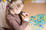 Cute little girl solving puzzles Stock Image