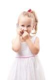 Cute little girl speak on phone isolated Stock Photos