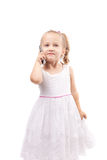 Cute little girl speak on phone isolated Royalty Free Stock Image