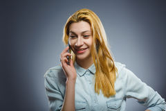 Cute little girl speaking on the cell phone. isolated on gray Stock Photo