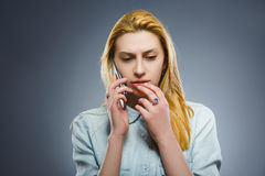 Cute little girl speaking on the cell phone. isolated on gray Royalty Free Stock Photo