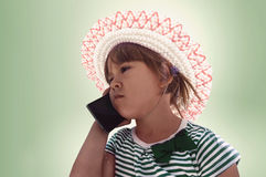 Cute little girl speaking on the cell phone Stock Photo