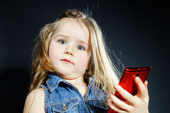 Free Cute Little Girl Speaks Using New Cell Phone. Stock Photos - 48604513