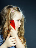 Cute little girl speaks using new cell phone. Stock Photography