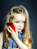 Cute little girl speaks using new cell phone. Royalty Free Stock Photo