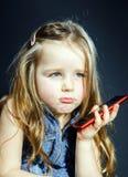 Cute little girl speaks using new cell phone. Stock Image