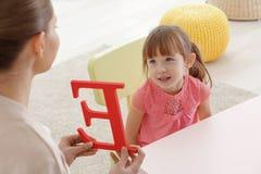 Cute little girl at speech therapist. Office Stock Photo