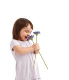 Cute little girl with spring flowers Royalty Free Stock Photography