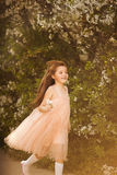 Cute little girl in a spring garden Royalty Free Stock Photography