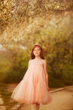 Cute little girl in a spring garden Royalty Free Stock Photo