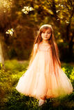 Cute little girl in a spring garden Royalty Free Stock Photos