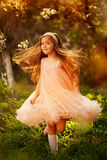 Cute little girl in a spring garden Stock Photo