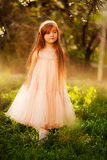 Cute little girl in a spring garden Royalty Free Stock Image