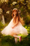Cute little girl in a spring garden Stock Photography