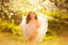 Cute little girl in a spring garden Stock Photography
