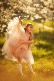 Cute little girl in a spring garden Stock Photo