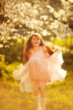 Cute little girl in a spring garden Royalty Free Stock Images