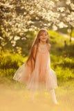 Cute little girl in a spring garden Royalty Free Stock Photos