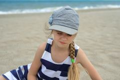 Cute little girl squinted. On the beach Royalty Free Stock Photography