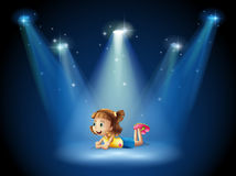 A cute little girl at the stage with spotlights Royalty Free Stock Image