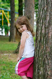 Girl against a tree Stock Image
