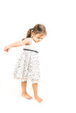 Cute little girl standing barefoot isolated Stock Image