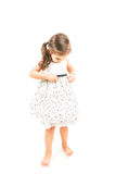 Cute little girl standing barefoot isolated Stock Photography