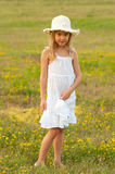 Cute little girl standing on the meadow Royalty Free Stock Photography
