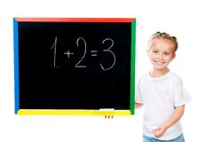 Cute little girl standing near blackboard Royalty Free Stock Images