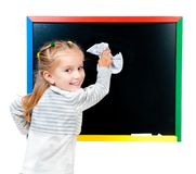 Cute little girl standing near blackboard Royalty Free Stock Image