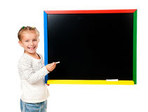 Cute little girl standing near blackboard Royalty Free Stock Photos