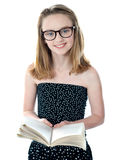 Cute little girl standing with an open book Royalty Free Stock Photos