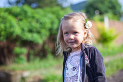 Cute little girl standing outdoor and laughting Royalty Free Stock Images