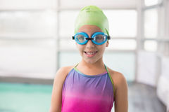 Cute little girl standing poolside Royalty Free Stock Images