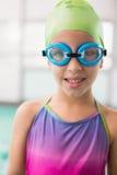 Cute little girl standing poolside Stock Image
