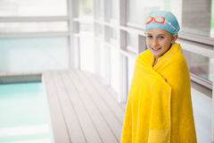 Cute little girl standing poolside wrapped in towel Stock Photography