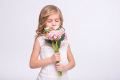 Cute little girl standing in  a wedding dress Royalty Free Stock Photos